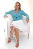 Lorre White in white chair